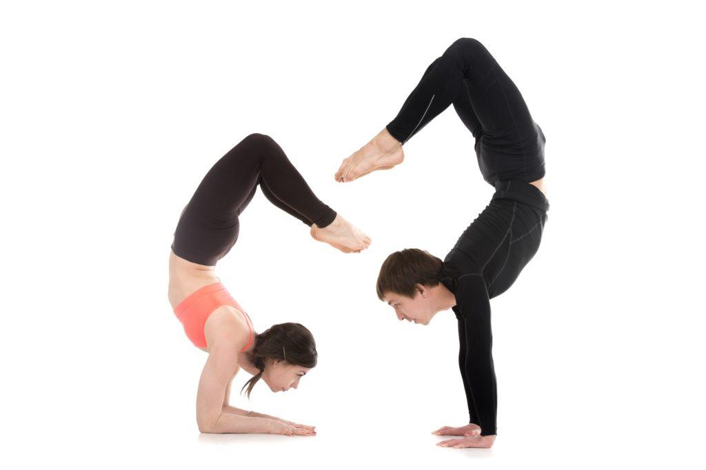 Yogi couple in yoga Scorpion Pose